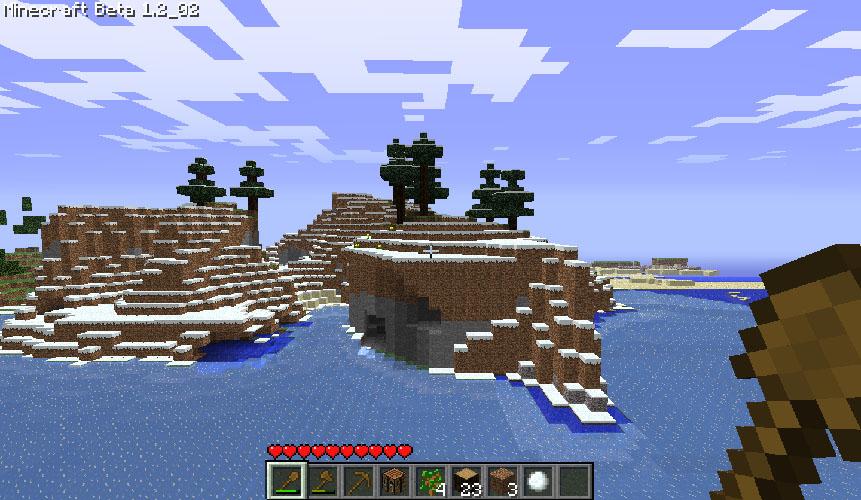 Um lago congelado encontrado após uma colina. Humm, o que será que tem dentro daquela caverna?